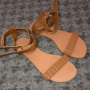 Strapped brown sandals